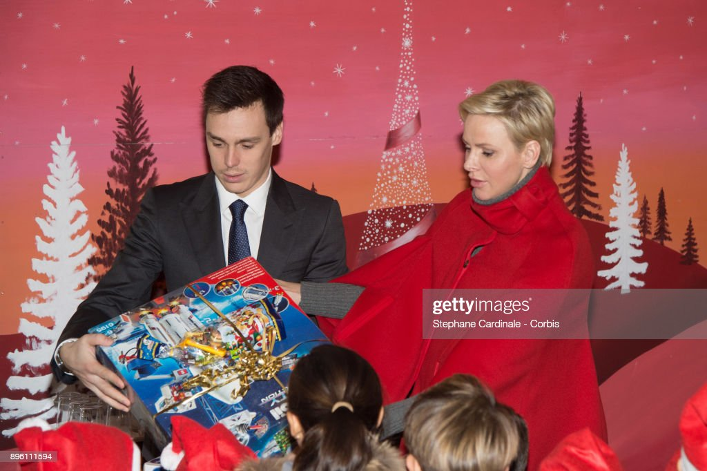 Louis Ducruet and Princess Charlene of Monaco attend the Christmas Gifts Distribution on December 20, 2017 in Monaco, Monaco.