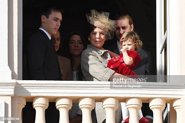 Louis Ducruet, Princess Caroline of Hanover and India Casiraghi greet the crowd from the palace's balcony during the Monaco National Day Celebrations...