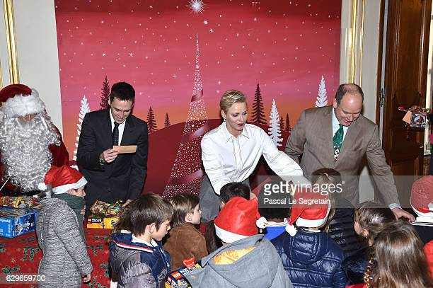 Louis Ducruet, Princess Charlene Of Monaco and Prince Albert II of Monaco attend the annual Christmas gifts distribution at Monaco Palace on December...