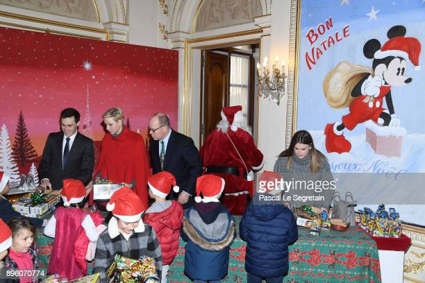 Louis Ducruet Princess Charlene of Monaco Prince Albert II of Monaco and Camille Gottlieb attend the Christmas Gifts Distribution on December 20 2017...