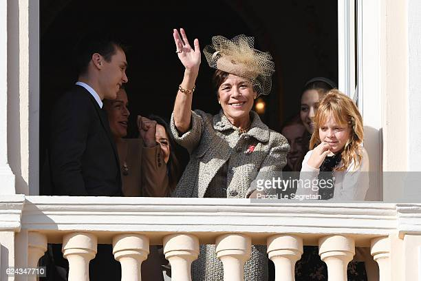 Louis Ducruet, Princess Stephanie of Monaco and Princess Caroline of Hanover greet the crowd from the palace's balcony during the Monaco National Day...
