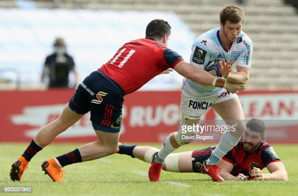 Louis Dupichot of Racing 92 charges moves away from Sammy Arnold as Alex Wootton tackles during the European Rugby Champions Cup SemiFinal match...