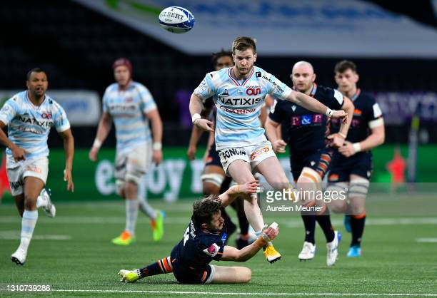 Louis Dupichot of Racing 92 is tackled by Henry Pyrgos of Edinburgh during the Round of 16 Champions Cup match between Racing 92 and Edinburgh Rugby...