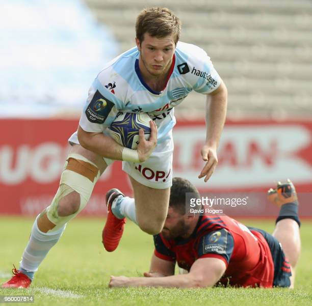 Louis Dupicot of Racing 92 breaks clear of Sammy Arnold during the European Rugby Champions Cup SemiFinal match between Racing 92 and Munster Rugby...