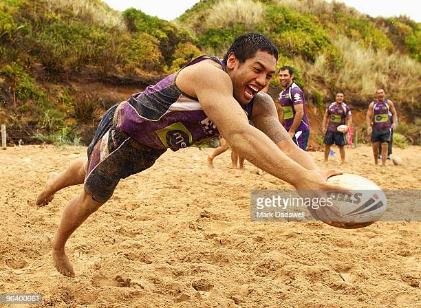Louis Fanene of the Storm dives to score a try in a game of touch during a Melbourne Storm NRL training session at Anglesea Beach on February 4 2010...