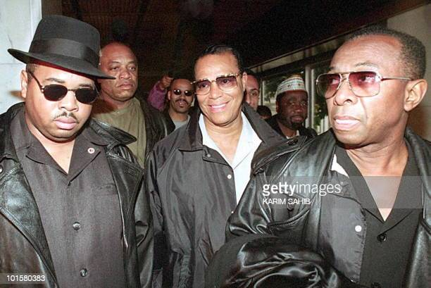 Louis Farrakhan leader of the Nation of Islam is surrounded 09 December by bodyguards as he arrives in Baghdad The Black Moslem leader is on a...