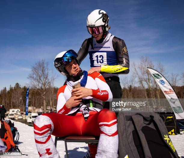 """Louis Fausa of the University of Colorado and Wilhelm C Normannseth of the University of Utah between runs of the men""""u2019s giant slalom on the..."""