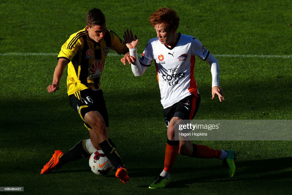 Louis Fenton of the Phoenix and Corey Brown of the Roar compete for the ball during the round 10 A-League match between the Wellington Phoenix and Brisbane Roar at Westpac Stadium on December 14, 2013 in Wellington, New Zealand.
