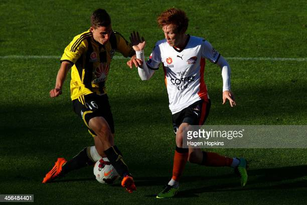 Louis Fenton of the Phoenix and Corey Brown of the Roar compete for the ball during the round 10 ALeague match between the Wellington Phoenix and...