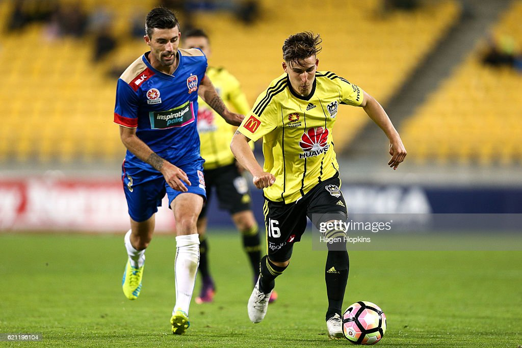 Louis Fenton of the Phoenix holds off the challenge of Jason Hoffman of the Jets during the round five A-League match between the Wellington Phoenix and the Newcastle Jets at Westpac Stadium on November 5, 2016 in Wellington, New Zealand.
