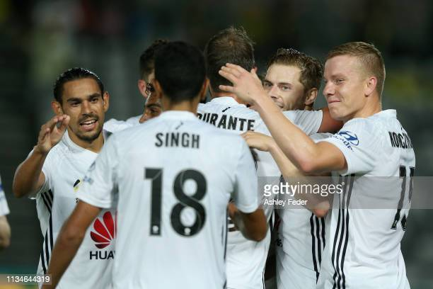 Louis Fenton of Wellington Phoenix celebrates his goal with team mates during the round 21 ALeague match between the Central Coast Mariners and the...