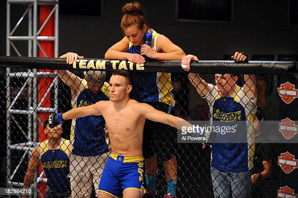 Louis Fisette stands in his corner with Coach Miesha Tate prior to facing David Grant in their preliminary fight during filming of season eighteen of...