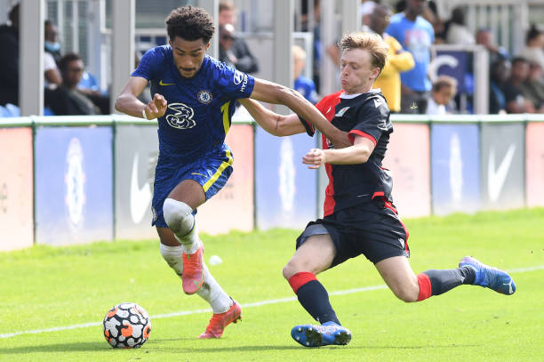 Louis Flower of Chelsea runs with the ball during the Chelsea v Blackburn Rovers U18 Premier League Cup Group D on September 18, 2021 in Cobham,...