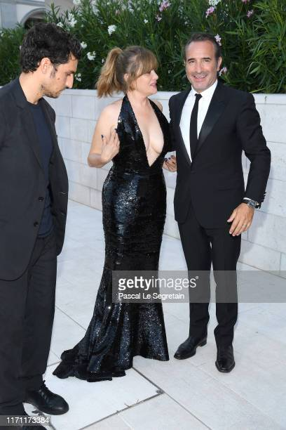 """Louis Garrel, Emmanuelle Seigner and Jean Dujardin walk the red carpet ahead of the """"J'Accuse"""" screening during the 76th Venice Film Festival at Sala..."""