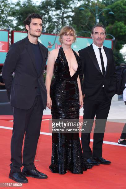 Louis Garrel Emmanuelle Seignier Jean Dujardin walk the red carpet ahead of the J'Accuse screening during the 76th Venice Film Festival at Sala...