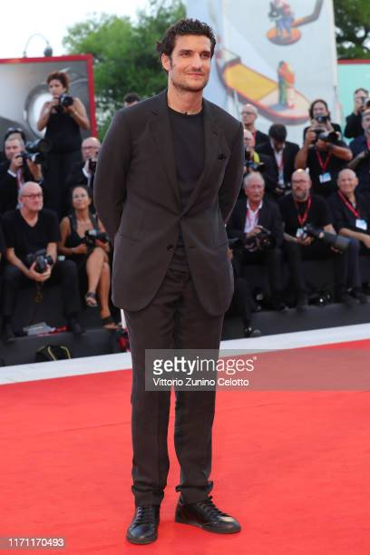 Louis Garrel walks the red carpet ahead of the J'Accuse screening during the 76th Venice Film Festival at Sala Grande on August 30 2019 in Venice...