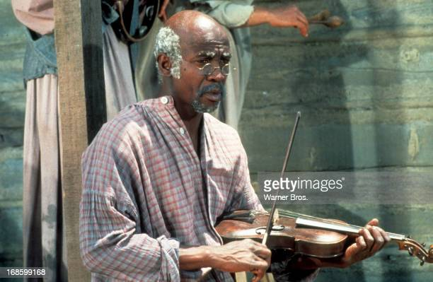 Louis Gossett Jr holding violin in a scene from the Television Series 'Roots' 1977