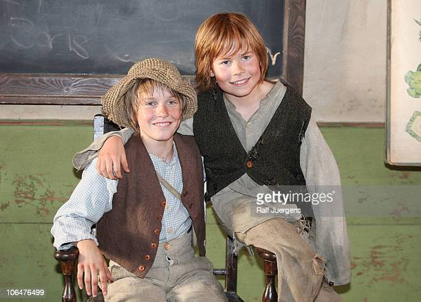 Louis Hofmann as Tom Sawyer and Leon Seidel as Huckleberry Finn attend a photocall to promote the movie Tom Sawyer at the MMC Studios on November 3...