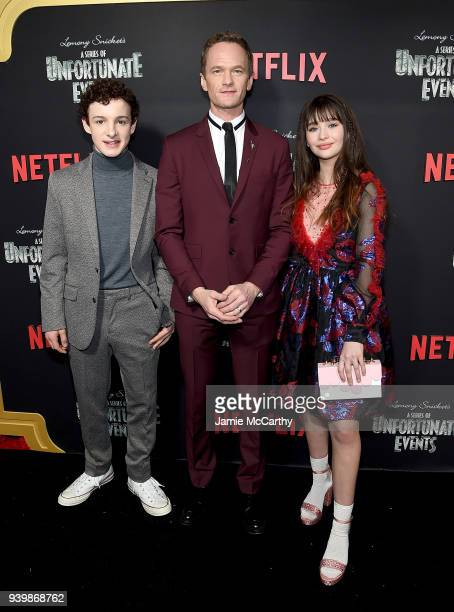 Louis HynesNeil Patrick Harris and Malina Weissman attend the 'A Series Of Unfortunate Events' Season 2 Premiere at Metrograph on March 29 2018 in...