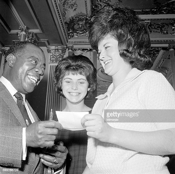 Louis is seen here signing autographs May 1962 Q3831