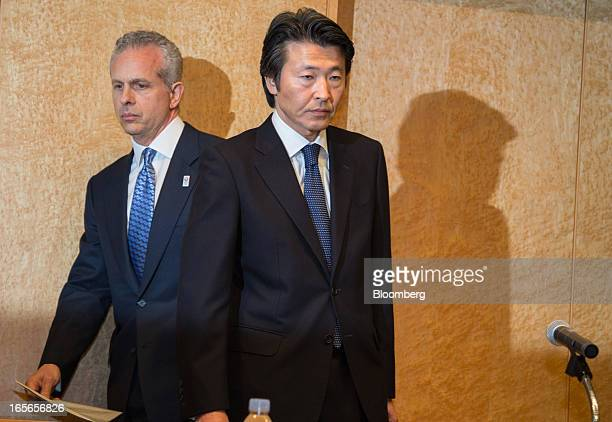 Louis J. Forster, senior managing director of Cerberus Capital Management LP, left, and Yoshiteru Suzuki, president of Cerberus Capital Management LP...