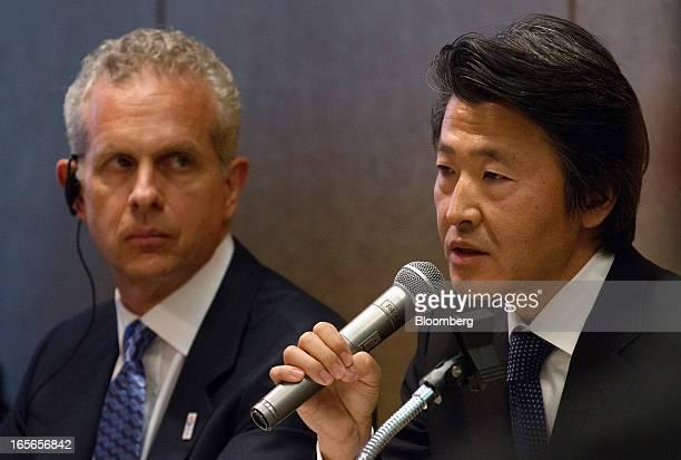 Louis J. Forster, senior managing director of Cerberus Capital Management LP, left, listens while Yoshiteru Suzuki, president of Cerberus Capital...