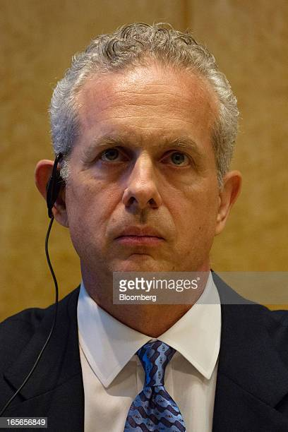 Louis J. Forster, senior managing director of Cerberus Capital Management LP, left, pauses during a news conference in Tokyo, Japan, on Friday, April...