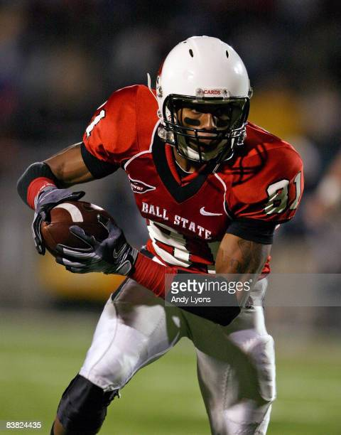 Louis Johnson of the Ball State Cardinals runs with the ball during the MidAmerican Conference game against the Western Michigan Broncos at Scheumann...