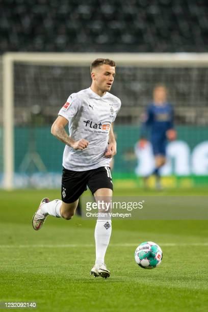 Louis Jordan Beyer of Borussia Moenchengladbach in action during the Bundesliga match between Borussia Moenchengladbach and SC Freiburg at...