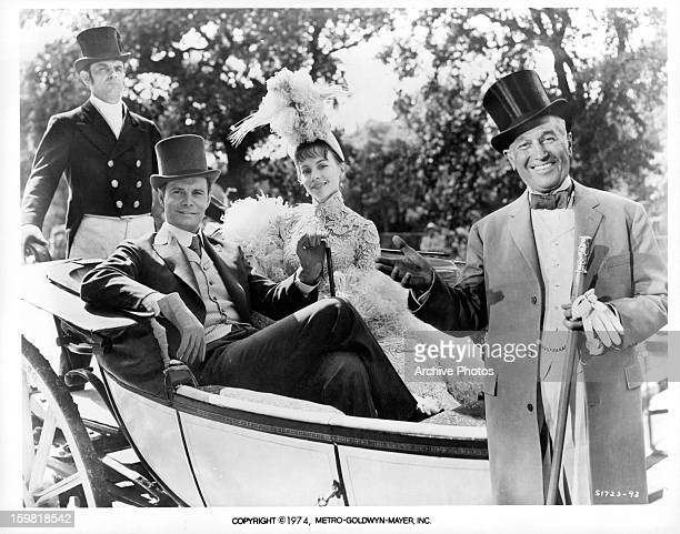 Louis Jourdan and Leslie Caron in carriage with a smiling Maurice Chevalier in front of them in publicity portrait for the film 'Gigi' 1958