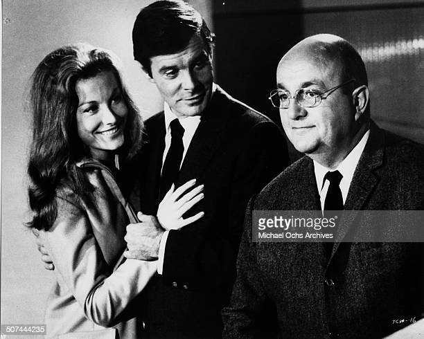 Louis Jourdan introduces a new friend to Bernard Blier in a scene from the movie To Commit a Murder circa 1967