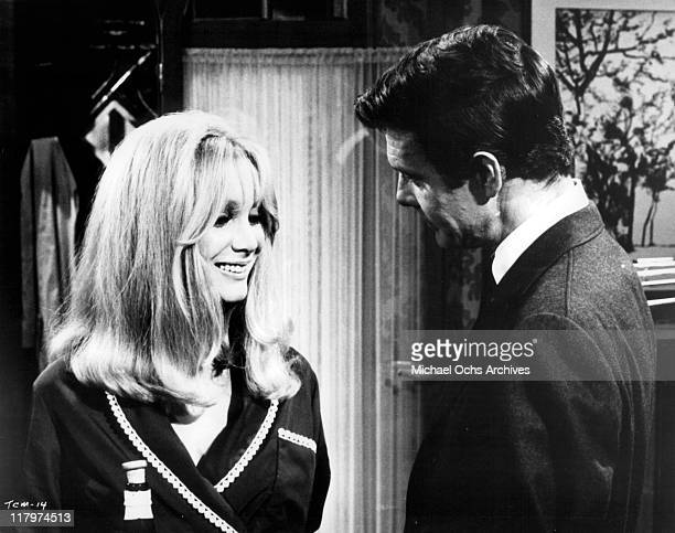 Louis Jourdan meets his friend's wife Patricia Scott in a scene from the film 'To Commit a Murder' 1967