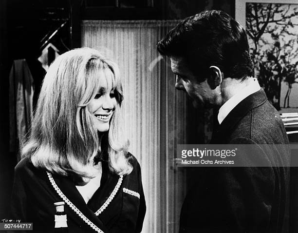 Louis Jourdan meets Patricia Scott in a scene from the movie To Commit a Murder circa 1967