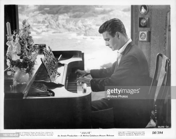 Louis Jourdan plays piano in a scene from the film 'Julie' 1956