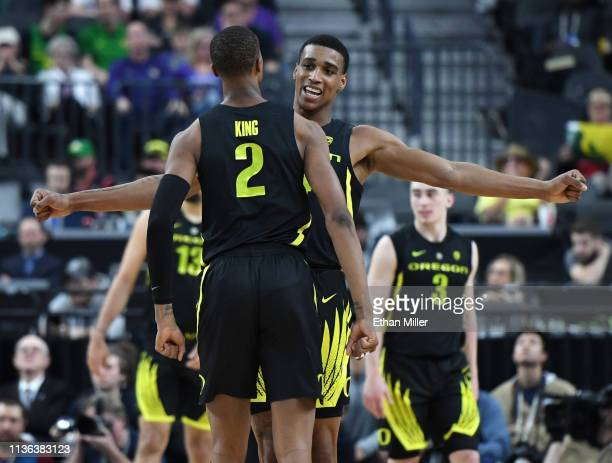 Louis King and Kenny Wooten of the Oregon Ducks celebrate during the championship game of the Pac12 basketball tournament against the Washington...