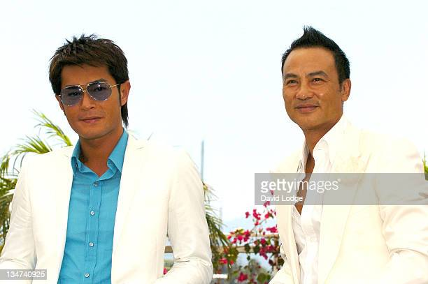 Louis Koo and Simon Yam during 2006 Cannes Film Festival 'Election 2' Photocall at Palais des Festival Terrace in Cannes France