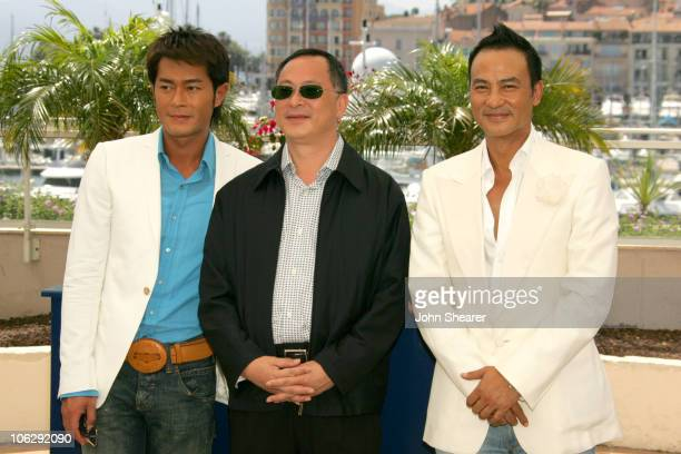 Louis Koo Johnnie To and Simon Yam during 2006 Cannes Film Festival 'Election 2' Photocall at Palais des Festival Terrace in Cannes France