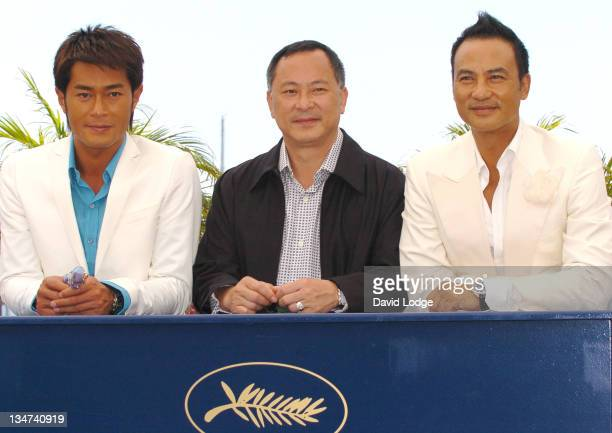 Louis Koo Johnnie To director and Simon Yam during 2006 Cannes Film Festival 'Election 2' Photocall at Palais des Festival Terrace in Cannes France