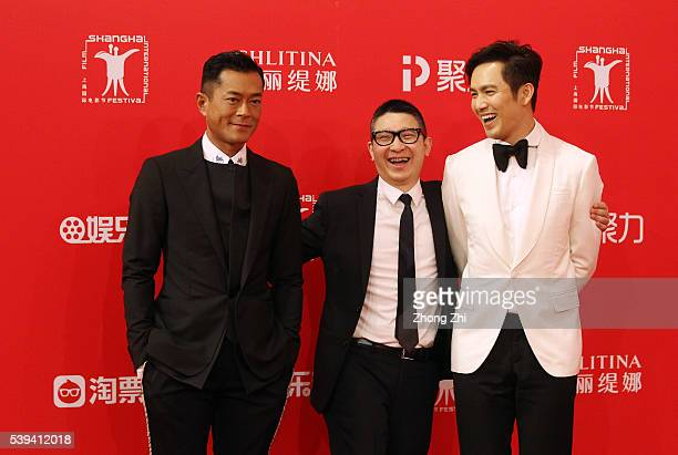 Louis Koo NaiHoi Yau and Wallace Chung arrives for the red carpet of the 19th Shanghai International Film Festival at Shanghai Grand Theatre on June...