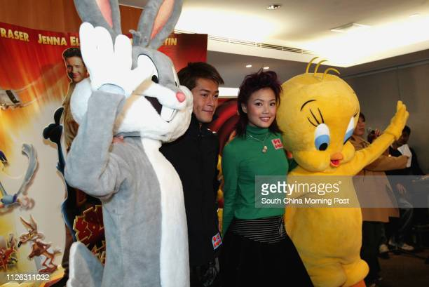Louis Koo Tinlok and Joey Yung Choyee local dubbing for Brendan Fraser and Jenna Elfman ih the Looney Tunes Back in Action' movie are pictured in a...