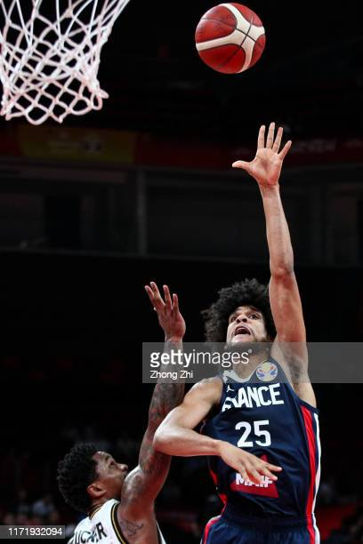 Louis Labeyrie of the France National Team in action against Dar Tucker of the Jordan National Team during the 1st round of 2019 FIBA World Cup at...