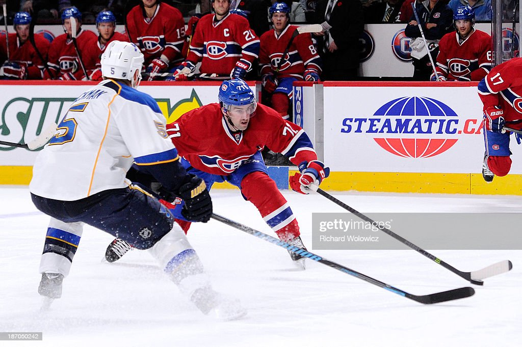 Louis Leblanc #71 of the Montreal Canadiens attempts to move the puck past Barret Jackman #5 of the St. Louis Blues during the NHL game at the Bell Centre on November 5, 2013 in Montreal, Quebec, Canada. The Blues defeated the Canadiens 3-2 in a shootout.