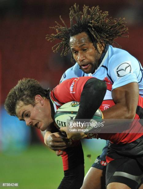 Louis Ludik of the Lions tackled by Lote Tuqiri of the Waratahs during the Super 14 match between Auto General Lions and Waratahs from CocaCola Park...