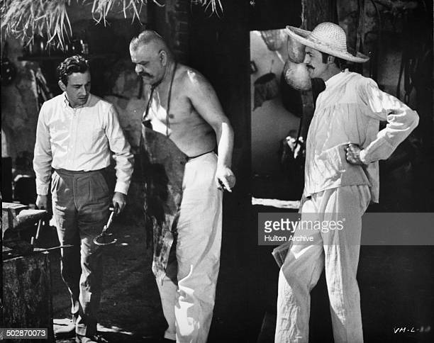Louis Malle directs Carlos L=pez Moctezuma as Claudio Brook looks on behind the scenes of the movie Viva Maria circa 1965