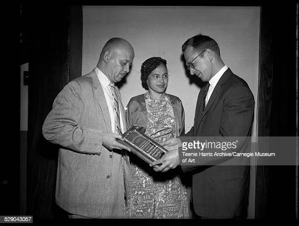 Louis Mason Jr of NAACP presenting plaque to KDKA program director Edward Young with Rosa Parks standing between them Pittsburgh Pennsylvania April...