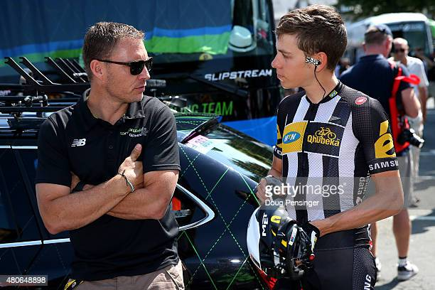 Louis Meintjes of South Africa and MTN-Qhubeka speaks with Robbie Hunter, Sporting Director of Team Cannondale-Garmin before stage ten of the 2015...