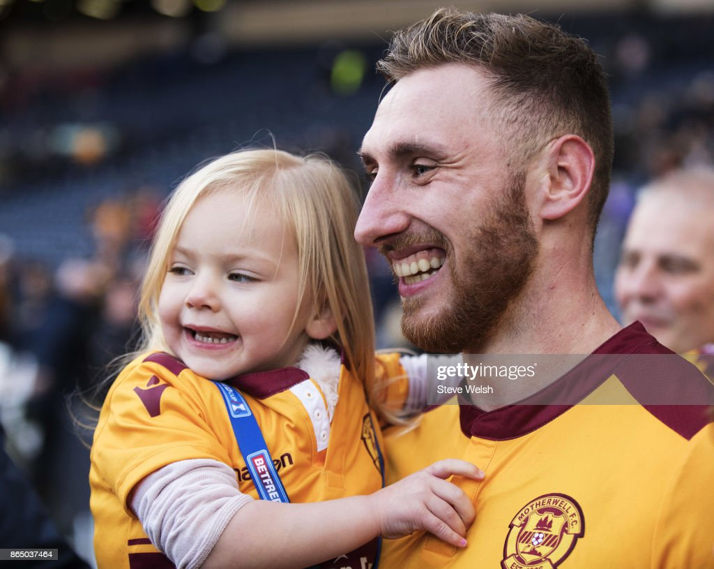 Louis Moult of Motherwell celebrates the end with his daughter Isla (3) after the Betfred Cup Semi Final at Hampden Park on October 22, 2017 in Glasgow, Scotland.
