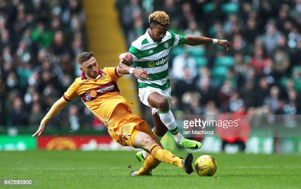 Louis Moult of Motherwell vies with Scott Sinclair of Celtic during the Ladbrokes Scottish Premiership match between Celtic and Motherwell at Celtic...