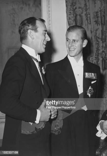 Louis Mountbatten, 1st Earl Mountbatten of Burma and his nephew Prince Philip, Duke of Edinburgh attend the National Playing Fields Association...