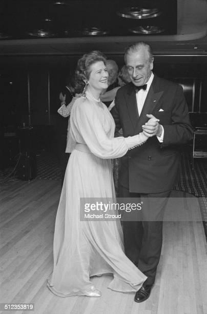 Louis Mountbatten 1st Earl Mountbatten of Burma enjoys a dance with Mary Soames Baroness Soames on board the Queen Elizabeth 2 ocean liner 1969